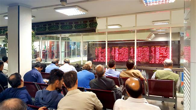 Traders watching shares developments at Tehran Stock Exchange (TSE).